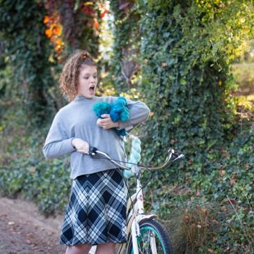 Girl dropping blue yarn