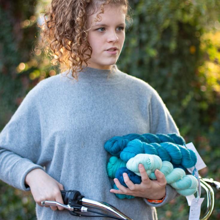 girl, bike, blue yarn