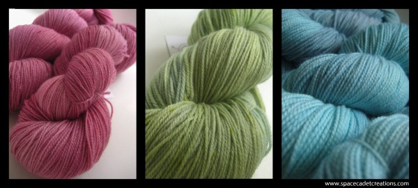 SpaceCadet Creations yarns for knitting and crochet, dyed in the colours of Camille Roskelley's quilt on a green bed