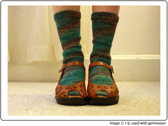 Rebecca's funky spiralled Submerge Socks, knit in SpaceCadet Creations yarn