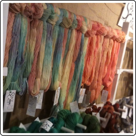 Setting up SpaceCadet yarns in the Melissa Jean Designs booth at Rhinebeck