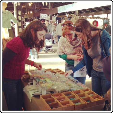 Choosing buttons at the Melissa Jean Designs booth at Rhinebeck