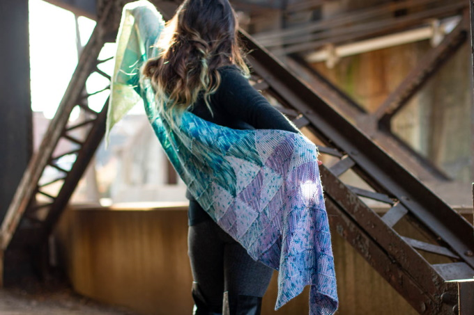 The Striad Wrap by Stephanie Alford, constructed in a series of short row triangles, knit individually in strips and joined together without any seaming up.